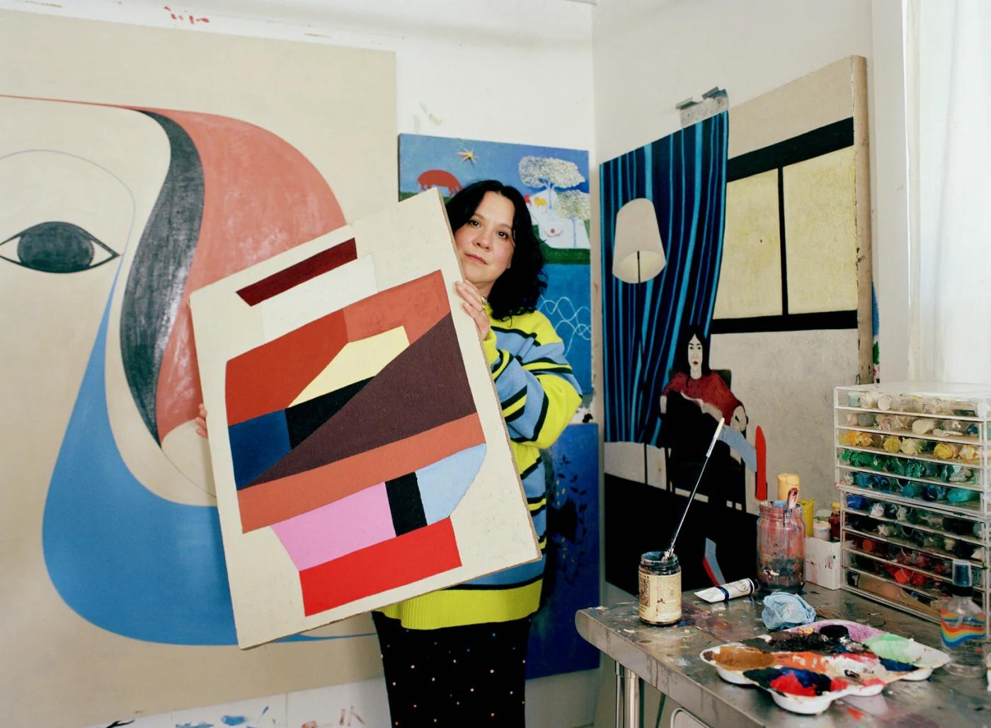 Clare Rojas holding a painting