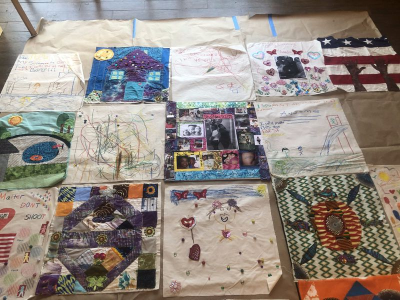 "Quilt squares created by mothers and children of St. Anthony Mother's Healing Together as a tribute to their deceased children.They adorn tent walls of a canopy that Sonja Henderson created. Image courtesy of ""Chicago Tribune"""