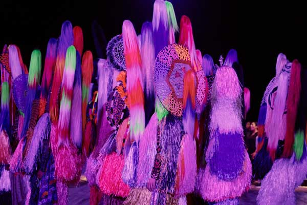 "Performers dancing, dressed in Nick Cave's large Soundsuits in ""Up Right"" at the Park Avenue Armory."