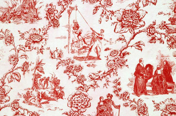 A red and white toile fabric featuring images of flowers and a white man in colonial-era military garb being hung by a black man  in similar clothing.