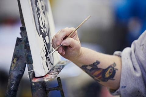 A student works on a painting