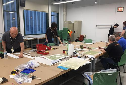 Students looking through print