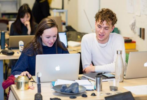 ACE Students work together on a Graphic Design Project