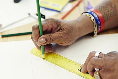 Student uses ruler to measure