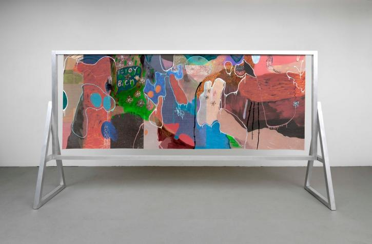 A colorful abstract canvas in a modern exhibition room