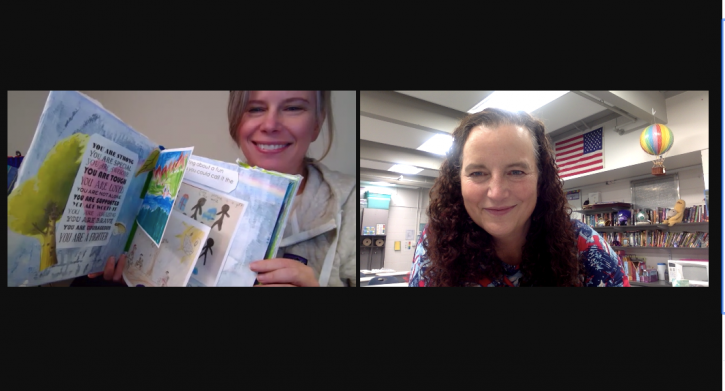 Two women on a Zoom call, one holding up a book of student artwork