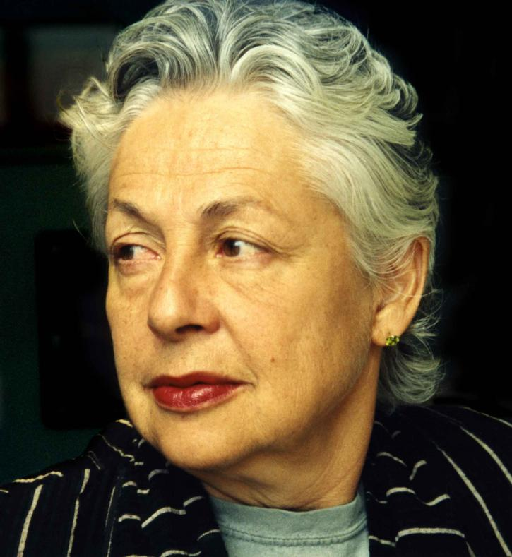 A white woman with short gray hair and red lipstick looking to the left.