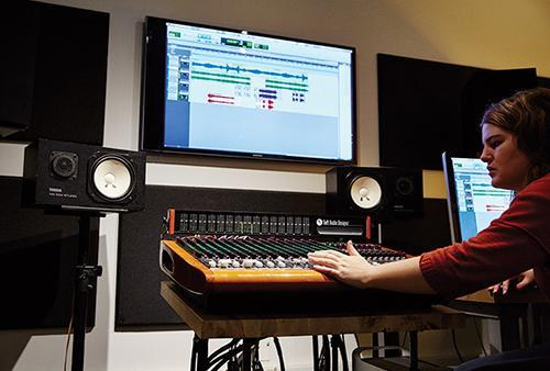 Student uses sound board
