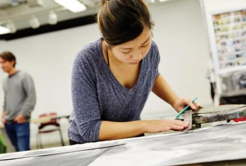Student works on drawing project