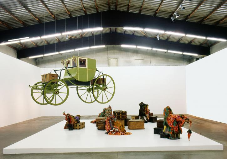 Yinka Shonibare CBE, Gallantry and Criminal Conversation, 2002, dimensions variable, eleven life-size fiberglass mannequins, Dutch wax printed cotton textile, metal and wood cases, leather, wood, steel.