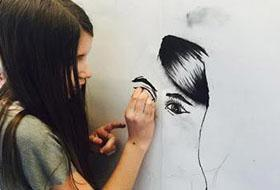 MSP Student works on a drawing