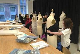 MSP Students work on draping with dress figures