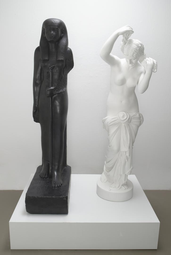 Fred Wilson, Mete of the Muse, 2006, bronze with black patina and bronze with white paint. Left figure: 65 x 26 x 14 inches: Right figure: 61 x 18 x 20 inches.