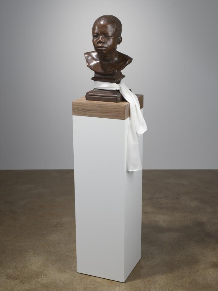 Fred Wilson, Ota Benga, 2008, bronze with silk scarf on wooden base, 59 ½ × 12 × 12 inches.