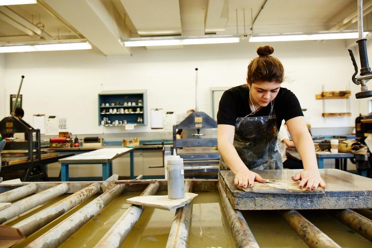 Student works on print project
