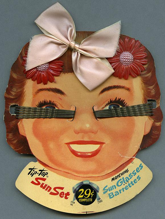 Hair clips attached to packaging of cartoon girl from RBSC archive