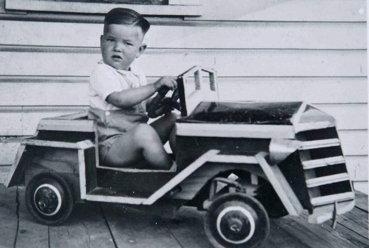 Roger Brown in soap box derby car made by his father