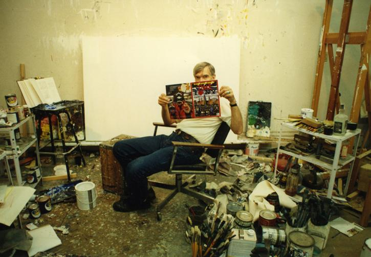 Roger Brown in his studio at 1926 N. Halsted St. (the Roger Brown Study Collection since 1997). Brown is holding a Time magazine which sports one of the two paintings he was commissioned to paint, by Time, for magazine covers.