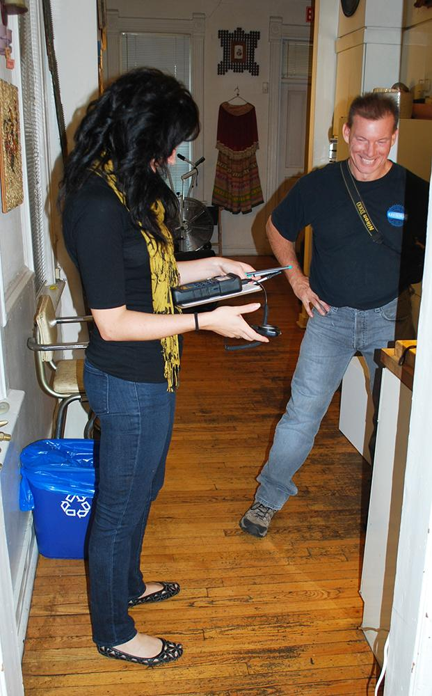Neal Vogel and Restoric staff member conducting the energy audit, 2010
