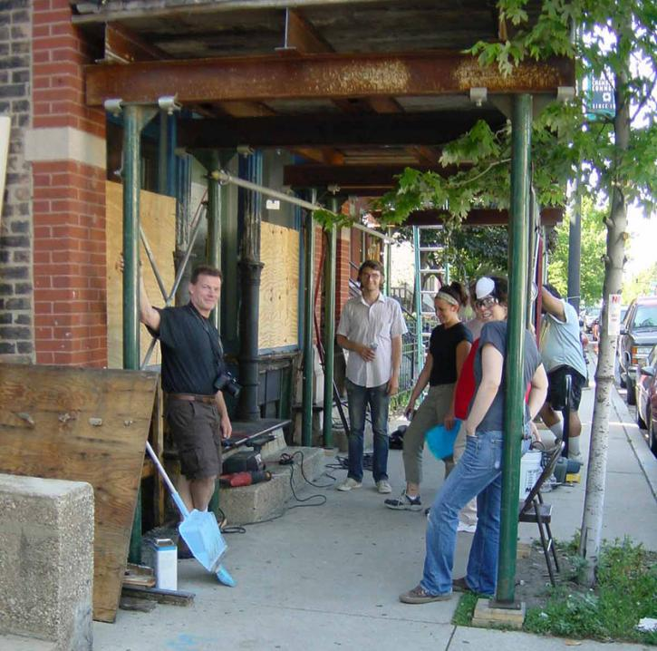 Neal Vogel and Restoration Methods class at work on the storefront, 2006