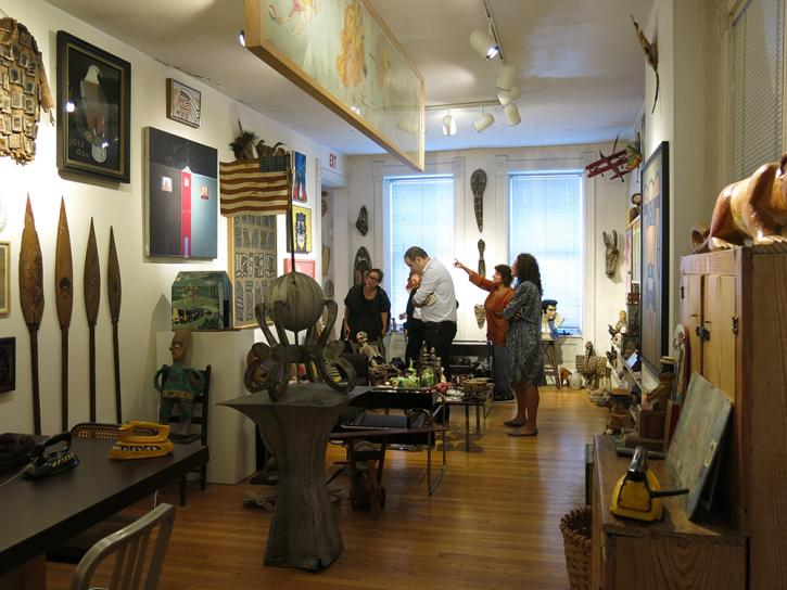Guests viewing the living room of the Roger Brown Study Collection
