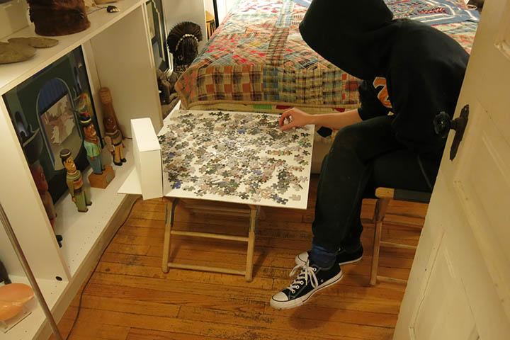 SAIC student doing puzzle in the collection