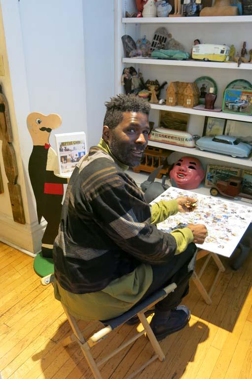 Kamau Patton working on an RBSC puzzle in the collection