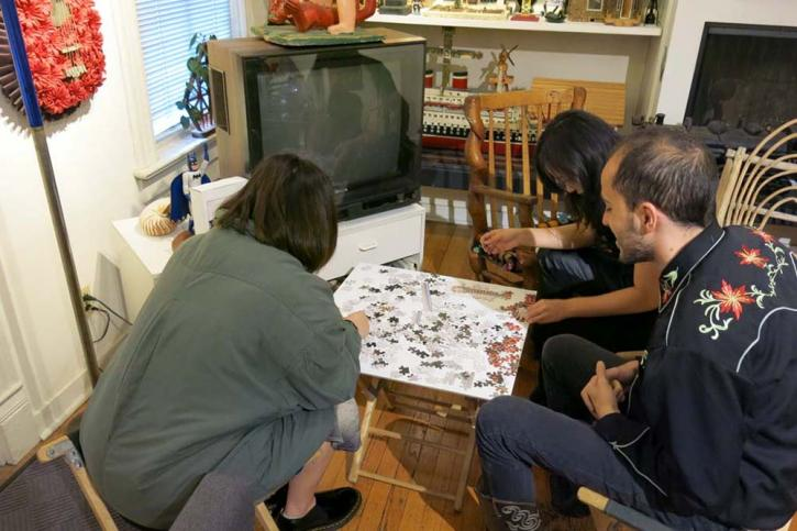 SAIC students doing a puzzle in the RBSC