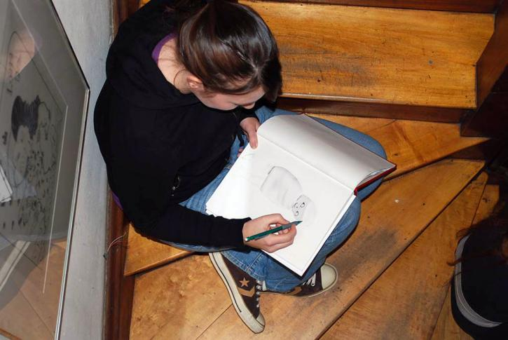 AIC students drawing in the RBSC stairway