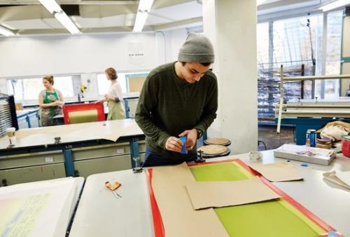 Student works on screen printing project
