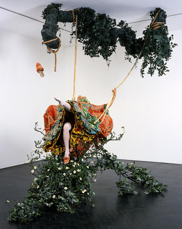 Yinka Shonibare CBE, The Swing (after Fragonard), 2001, 330 x 350 x 220 cm, life-size fiberglass mannequin, Dutch wax printed cotton textile, swing, artificial foliage.