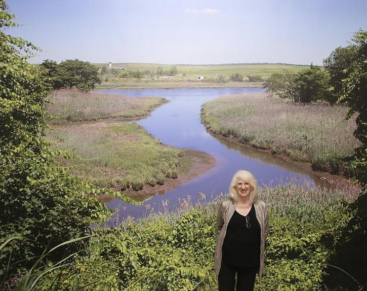 Mierle Laderman Ukeles standing at the site of LANDING/2016