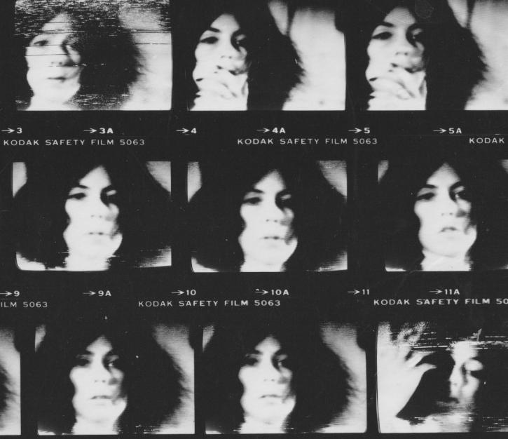 A contact sheet of nine black and white images of a white woman with dark hair in motion.