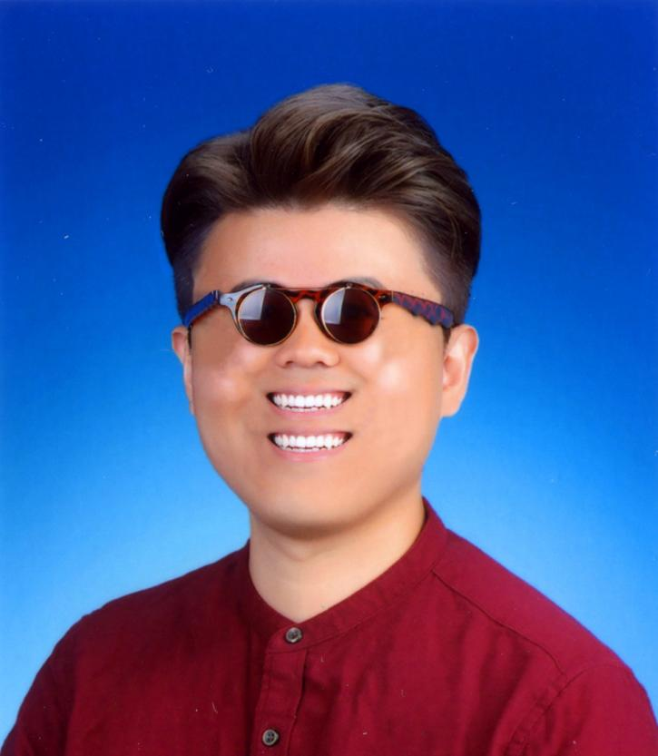 A portrait of the Asian artist Wong Ping wearing brown rimmed sunglasses and a red collarless shirt. His face is digitally altered. He has two smiling mouths, showing off pearly white teeth. The background is a gradient blue.