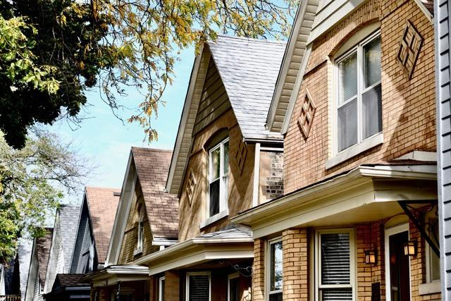 A row of workers cottages, two story, brick single family homes