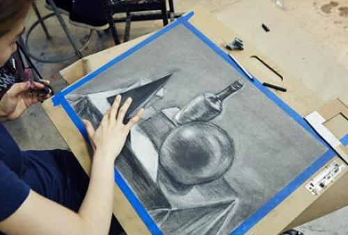 Student smudges a pencil sketch
