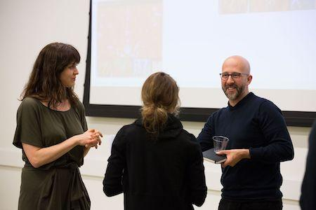 Art History faculty and speakers mingle after an event