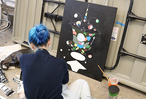 Student works on abstract art