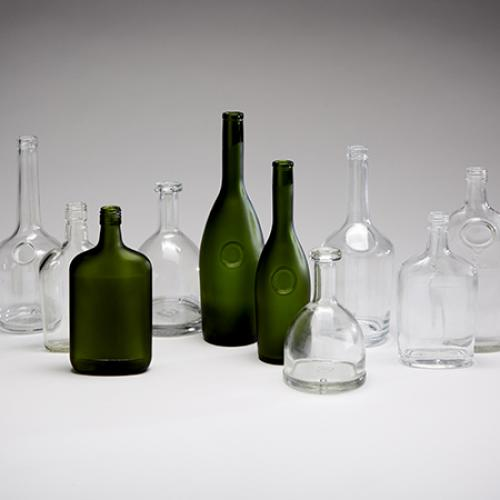 Frosted clear and green bottles of various shapes and size, still life photograph