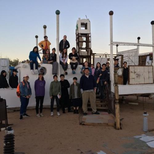 Study Abroad Students Group Photo on Structure in Joshua Tree