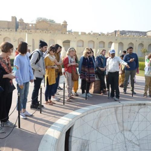 Study Abroad Students Listen to Lecture Outdoors