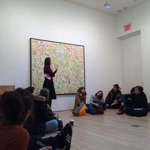 Study Abroad Students listen to gallery listen