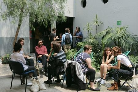 Study Abroad Students sitting in Mexico City and chatting with one another