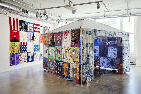 Tent with Quilts attached in gallery