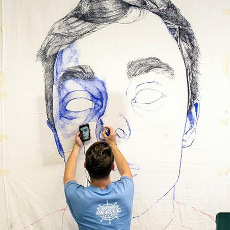 Student works on large scale drawing