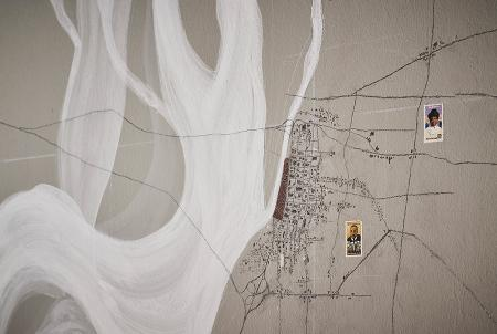 The Stone Stories installation at the U.S. Pavilion; this wall image features a plan of the Memphis with the landing rendered in dark brown. Photo © Tom Harris, courtesy of the School of the Art Institute of Chicago and the University of Chicago