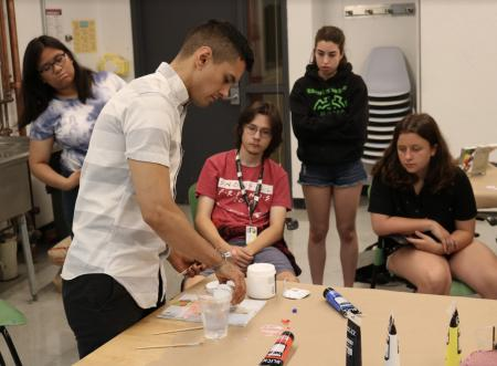 Mentor leads students through project