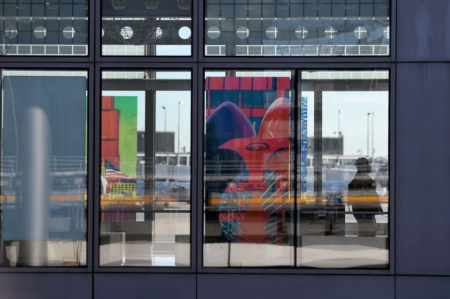 An image of Chicago's Picasso sculpture on display in a window at O'Hare International Airport