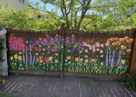 An image of flowers painted on a fence