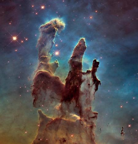 The Hubble gave us images like the Pillars of Creation, which depicts vast, star-generating columns interstellar gas some 6,500–7,000 light years from Earth.  Visual: NASA, ESA, and the Hubble Heritage Team